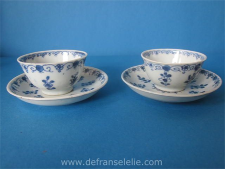 a pair of antique Chinese blue and white porcelain cups and saucers