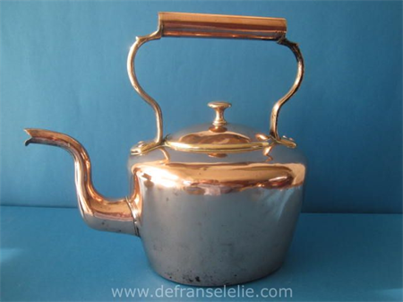 an antique Victorian copper teapot