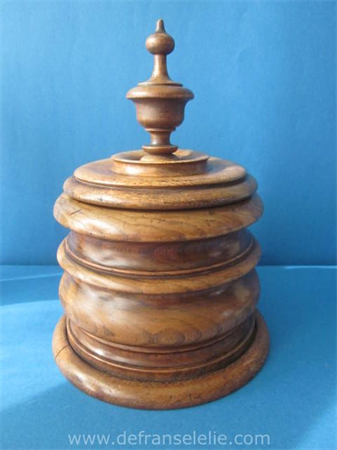 an antique turned wooden tobacco jar