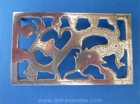 a vintage Chinese brass dragon trivet