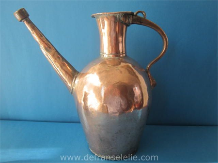 an antique handmade Middle East copper jug