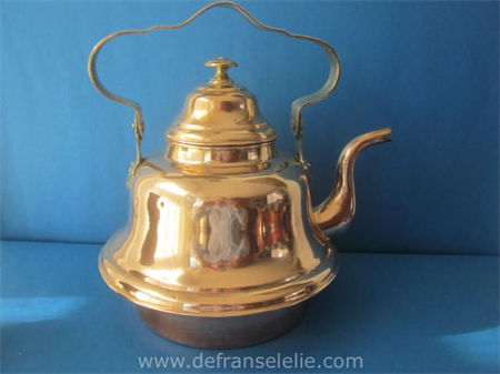 an antique Dutch brass copper kettle