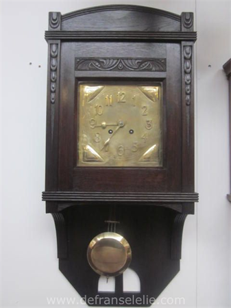a German oak art nouveau wall clock