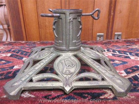 an antique cast iron Christmas tree stand