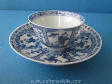 an antique Chinese blue and white porcelain cup and saucer Kangxi