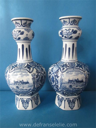 a pair of Delft style earthenware double gourd vases