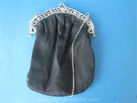 an antique Dutch silver purse with silver chain