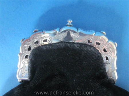 an antique Dutch silver purse with the crest of the seven Provinces of Holland