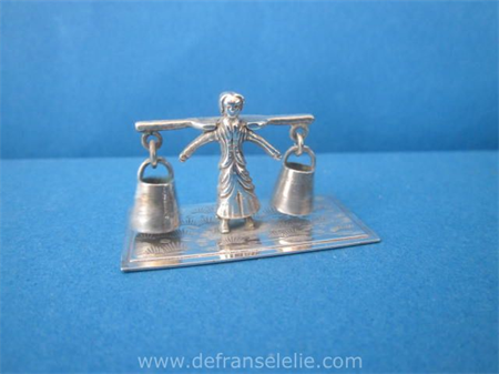 a vintage Dutch silver miniature of a milkmaid