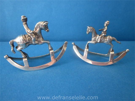 a pair of Dutch silver rocking horses
