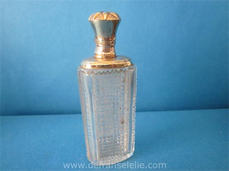 an antique Dutch perfume bottle with golden top