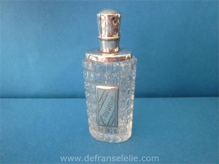 an antique Dutch glassl perfume bottle with silver top and front