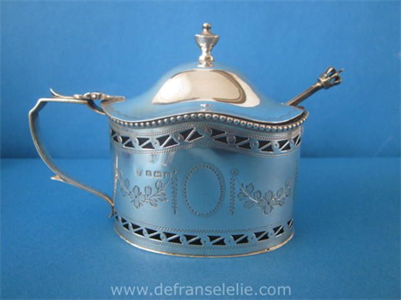 an antique sterling silver mustard pot
