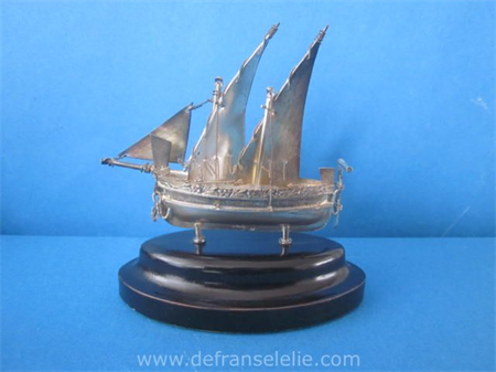 a vintage sterling silver miniature sailing boat