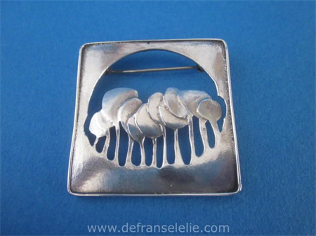a vintage sterling silver design brooch