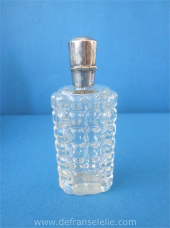an antique Dutch glass perfume bottle with silver top
