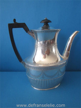 an antique sterling silver Louis Seize style teapot