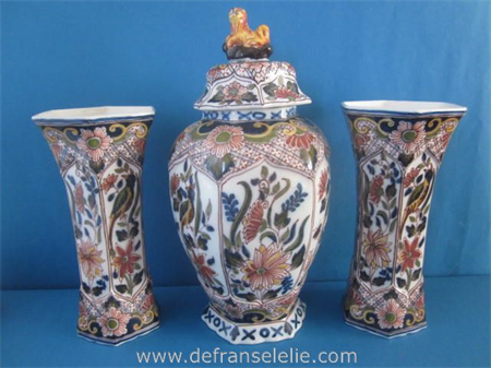 a vintage hand painted earthenware three piece Makkum garniture