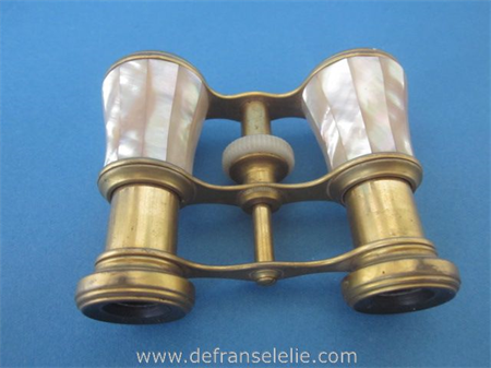 an antique mother of pearl opera glasses