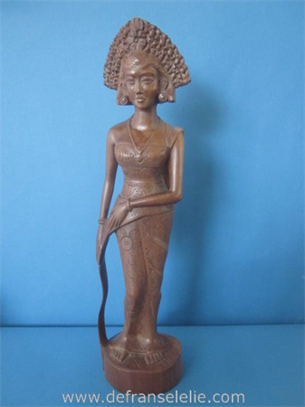 a vintage hand carved wooden Balinese figure