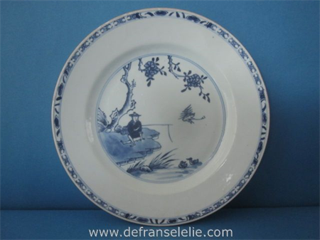 an antique Chinese blue and white porcelain plate fisherman