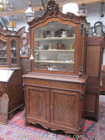 an antique Dutch mahogany display cabinet