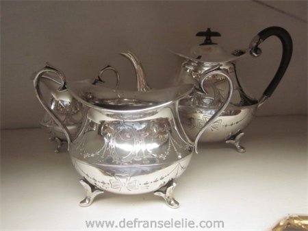 an antique three piece Louis Seize style silver plated tea set