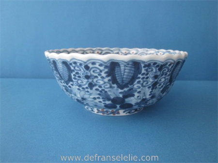 an earthenware hand painted blue and white Makkum bowl
