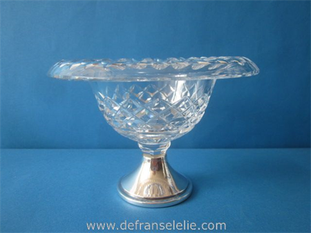 a vintage crystal bonbon dish with silver base