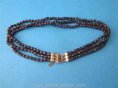 an antique three strand garnet necklace with gold lock