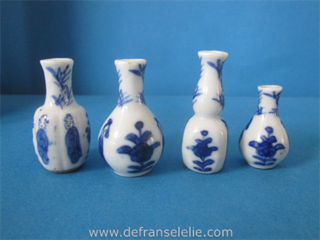 four antique Chinese blue and white dollhouse vases