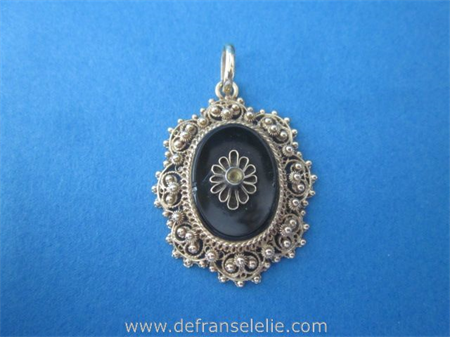 an antique 14ct gold filigree pendant
