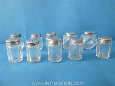 a small collection of vintage glass salts with silver top