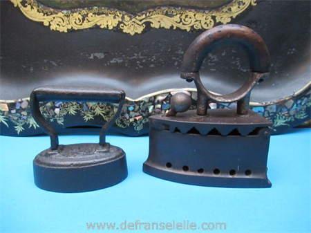 two small antique cast iron irons