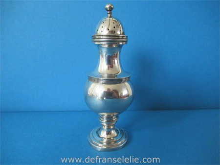 an antique Dutch silver pepper caster
