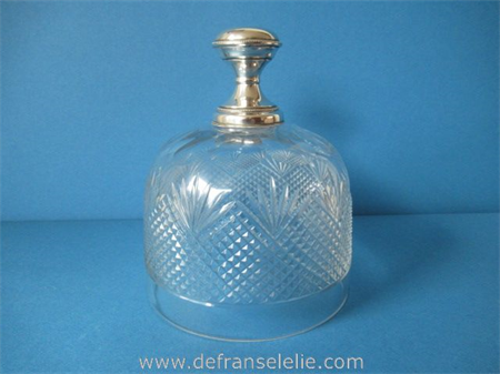 an antique cut crystal butter dish with silver top
