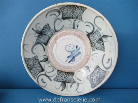 an antique Chinese blue and white Ming porcelain plate