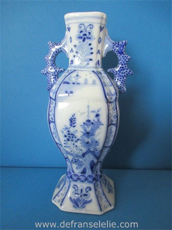 an antique hand painted earthenware Delft vase