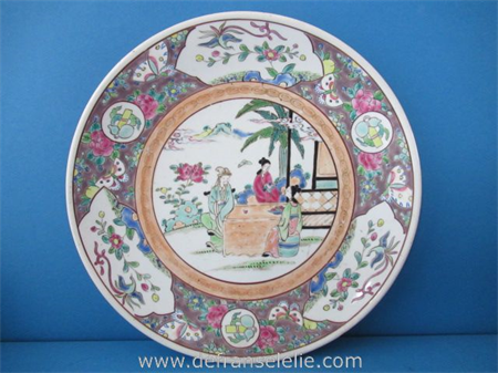 an antique polychrome Japanese porcelain charger