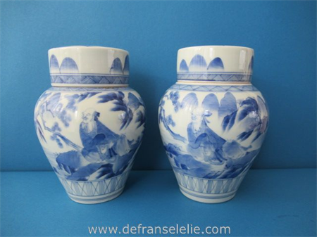 a pair of antique Japanese blue and white porcelain covered jars