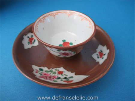 an antique Chinese Batavian brown porcelain cup and saucer