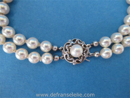 a vintage two strand cultured pearl necklace with silver lock