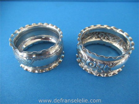 two antique sterling silver napkin rings