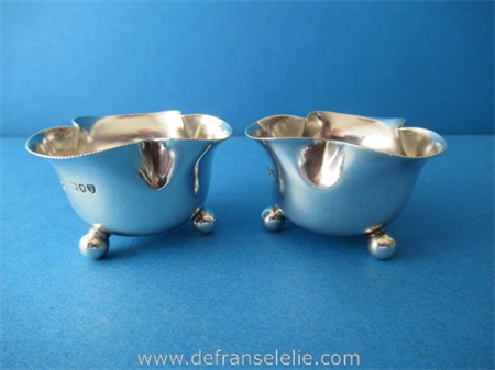 a pair of antique sterling silver salt cellars