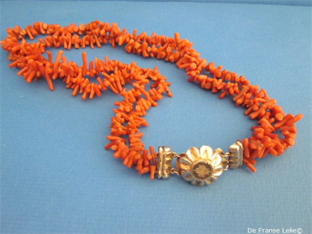 a late 19th century red coral necklace with 14ct gold clasp