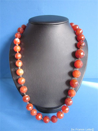a beautiful antique faceted carnelian necklace on a 14ct gold chain