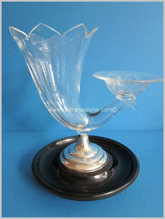 an antique crystal cigar beaker on a silver and ebonised mahogany foot