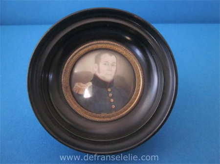 an antique hand painted miniature portrait