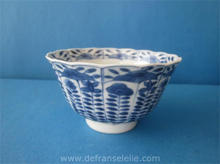 an antique Chinese blue and white porcelain cup