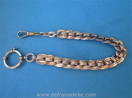 an antique copper pocket watch chain
